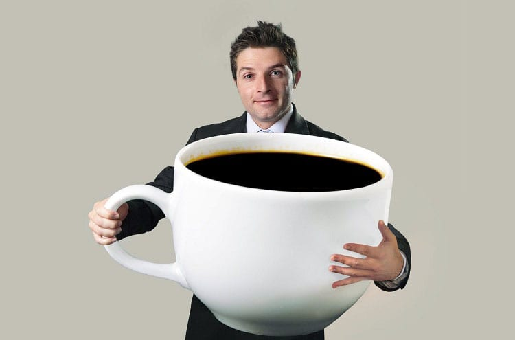 Man Holding Big Coffee Cup